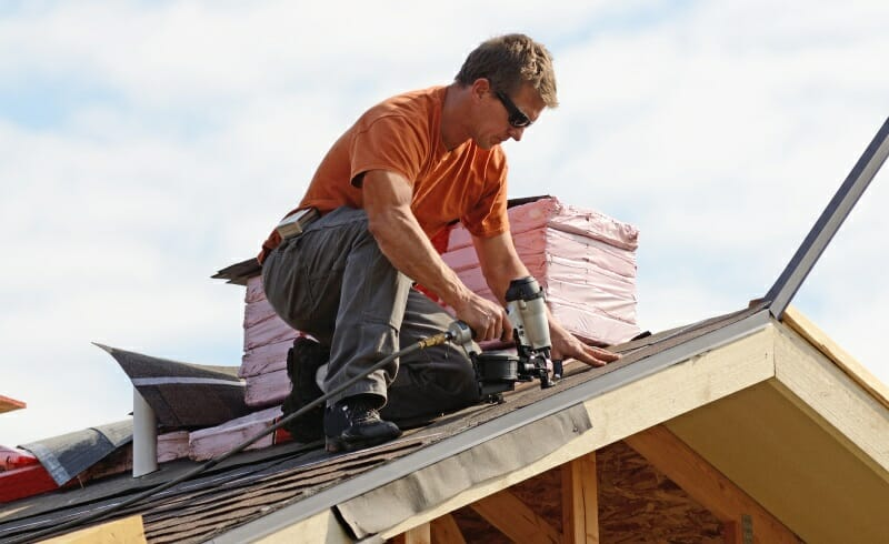 Roofing Specialist performing Roof Replacement Work
